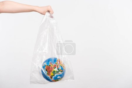 Photo for Cropped view of woman with outstretched hand holding globe in plastic bag isolated on white, global warming concept - Royalty Free Image