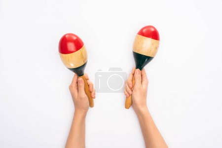 Photo for Cropped view of woman holding maracas on white background - Royalty Free Image