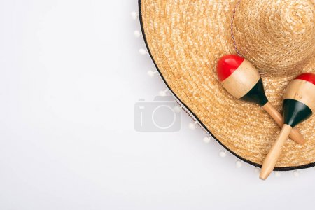 Photo for Top view of sombrero and maracas on white background - Royalty Free Image