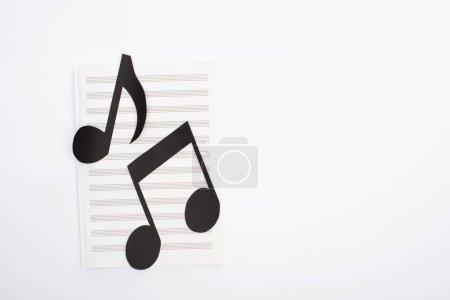 Photo pour Top view of paper cut notes on music book on white background - image libre de droit
