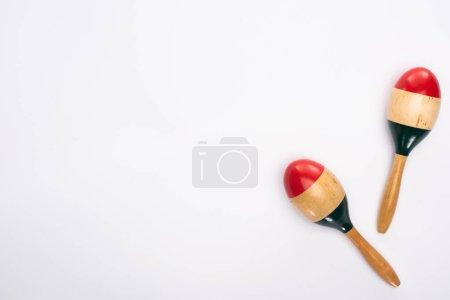 Photo for Top view of wooden colorful maracas on white background - Royalty Free Image