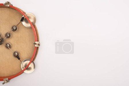 Photo pour Top view of tambourine on white background - image libre de droit