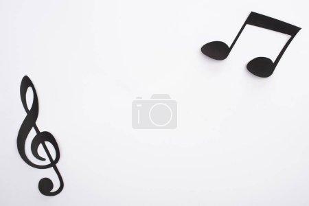 Photo pour Top view of paper cut black notes on white background - image libre de droit