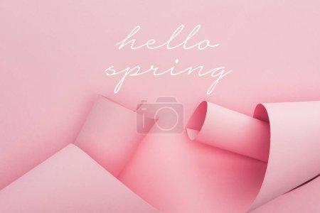 Photo pour Vue du haut des tourbillons de papier rose sur fond rose, illustration de printemps bonjour - image libre de droit