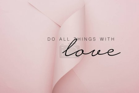 Photo pour Top view of pink paper swirl on pink background, do all thing with love illustration - image libre de droit