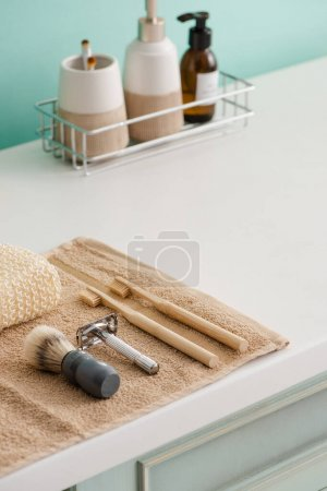 Photo pour Cosmetic products on shelf with hygiene objects on towel in bathroom, zero waste concept - image libre de droit