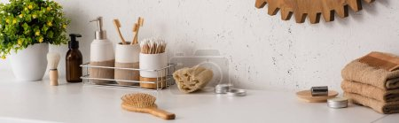 Photo for Panoramic view of shelf with hygiene objects and beauty products with flowerpot in bathroom, zero waste concept - Royalty Free Image