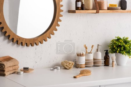 Photo for Bathroom with different beauty and hygiene objects with flowerpot and mirror, zero waste concept - Royalty Free Image