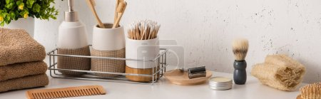 Photo for Panoramic view of different beauty and hygiene objects with flowerpot in bathroom, zero waste concept - Royalty Free Image