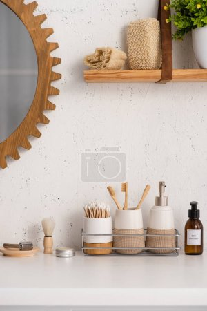Photo for Bathroom with eco friendly objects and cosmetic products on shelves, zero waste concept - Royalty Free Image