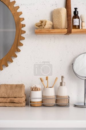 Photo for Bathroom with eco bamboo objects and cosmetic products on shelves, zero waste concept - Royalty Free Image