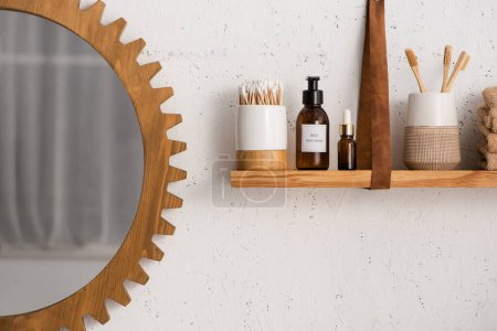 Shelf with beauty and cosmetic products with mirror in bathroom, zero waste concept