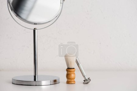 Photo for Close up view of round mirror, shaving brush and razor on white background, zero waste concept - Royalty Free Image