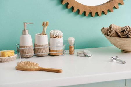Various hygiene objects, bowl with towels and mirror in bathroom, zero waste concept