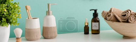 Photo for Panoramic view of flowerpot, cosmetic and hygiene products near bowl with towels in bathroom, zero waste concept - Royalty Free Image
