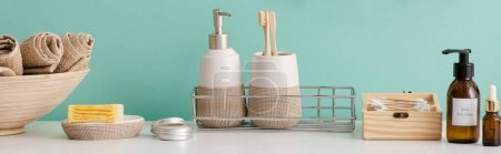 Photo for Panoramic view of bowl with towels and cosmetic and hygiene products in bathroom, zero waste concept - Royalty Free Image