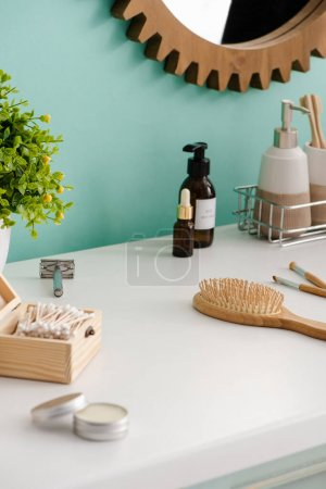 Photo for Selective focus of flowerpot with various beauty and hygiene products in bathroom, zero waste concept - Royalty Free Image