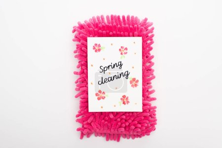 Photo for Top view of pink sponge and spring cleaning card on white background - Royalty Free Image