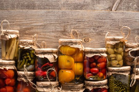 Photo for Top view of delicious homemade tasty pickles on wooden rustic table - Royalty Free Image