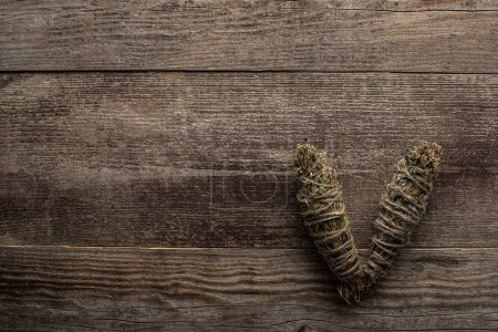Photo for Top view of herbal smudge sticks on wooden background - Royalty Free Image