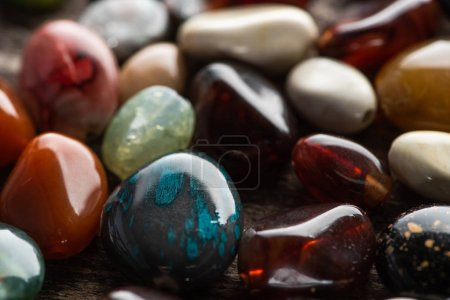 Photo for Close up view of colorful fortune telling stones on wooden background - Royalty Free Image