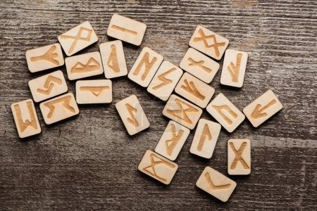 Photo for Top view of signs on runes on wooden background - Royalty Free Image