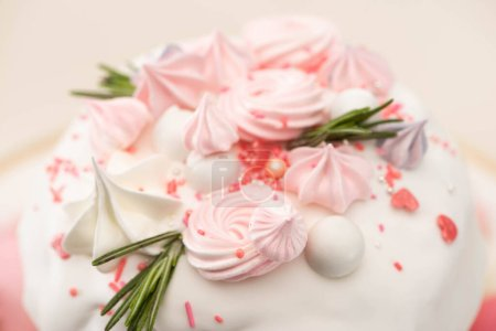 Photo for Close up view of tasty Easter cake with rosemary and meringue on glaze - Royalty Free Image