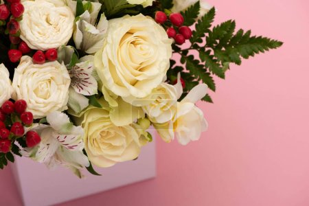Photo for Close up view of bouquet of flowers in festive gift box on pink background - Royalty Free Image