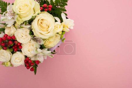 Foto de Top view of bouquet of flowers on pink background - Imagen libre de derechos