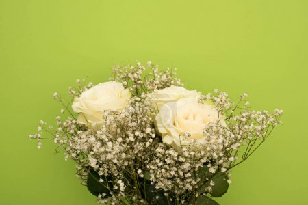 Photo for Top view of fresh bouquet of flowers isolated on green - Royalty Free Image