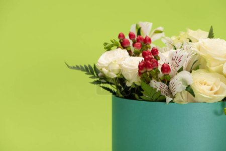Photo for Fresh bouquet of flowers in gift box isolated on green - Royalty Free Image