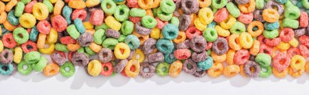Photo for Top view of bright multicolored breakfast cereal on white background, panoramic shot - Royalty Free Image