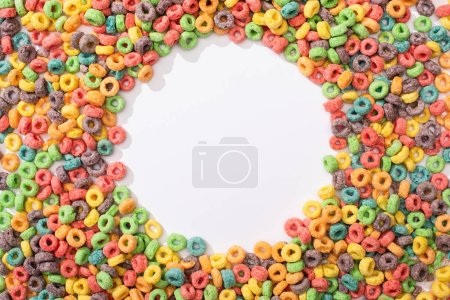 Photo for Top view of bright multicolored breakfast cereal arranged in round frame on white background - Royalty Free Image