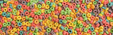 top view of bright multicolored breakfast cereal, panoramic shot