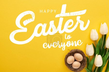 Photo pour Top view of tulips and chicken eggs in nest on colorful yellow background with happy Easter to everyone illustration - image libre de droit