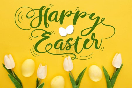 Photo for Top view of tulips and painted Easter eggs on colorful yellow background with happy Easter illustration - Royalty Free Image
