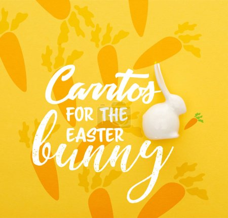 Photo for Top view of white Easter bunny on colorful yellow background with carrots for the easter bunny illustration - Royalty Free Image