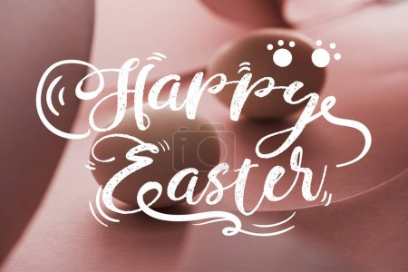 Photo for Selective focus of chicken eggs in shadow in spiral paper pink swirls with happy Easter illustration - Royalty Free Image