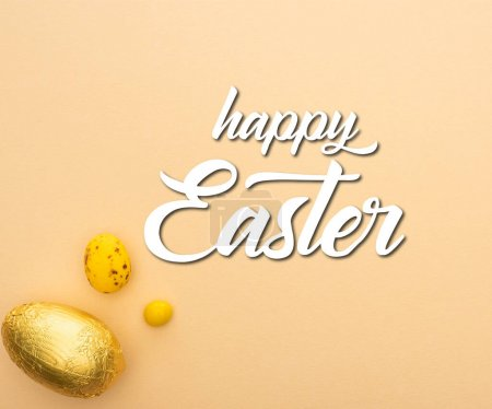 Photo for Top view of candy, quail and chocolate eggs on beige background with happy Easter illustration - Royalty Free Image