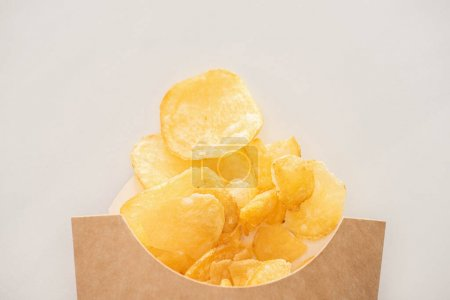 Photo for Top view of crunchy potato chips isolated on white - Royalty Free Image