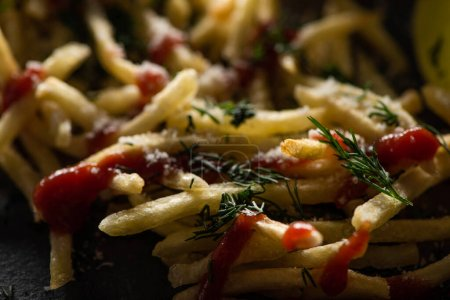 Photo for Close up of tasty french fries with ketchup, salt and dill - Royalty Free Image
