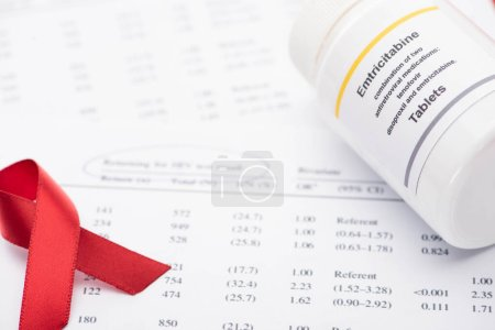 Photo for Close up view of returning for HIV test result form with pen, awareness ribbon and container with emtricitabine tablets - Royalty Free Image
