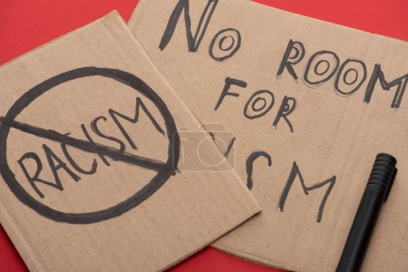 Photo for Carton placards with stop racism lettering on red background - Royalty Free Image