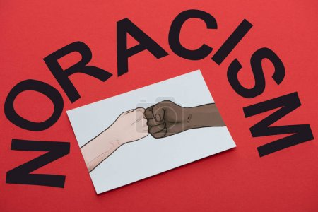black no racism lettering and picture with drawn multiethnic hands doing fist bump on red background
