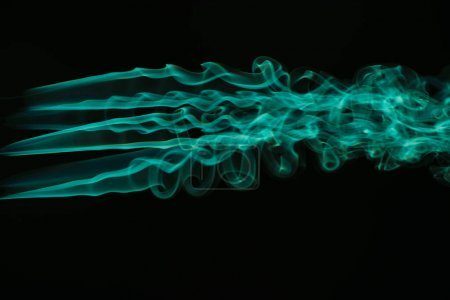 Photo for Green colorful flowing smoke on black background - Royalty Free Image