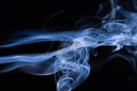 blue colorful flowing smoke on black background