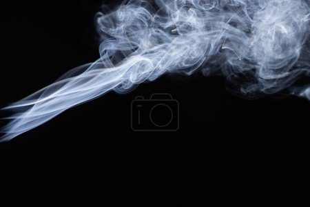 Photo for Abstract white flowing smoke clouds on black background - Royalty Free Image