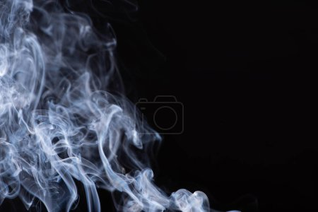 abstract white flowing smoke on black background