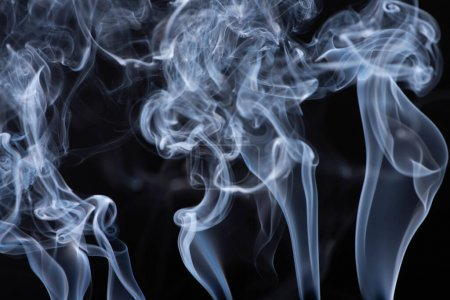 Photo for Abstract white flowing smoke on black background - Royalty Free Image