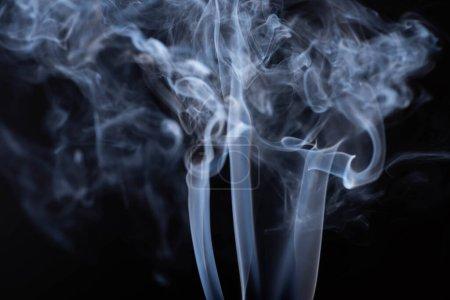 white flowing smoke on black background